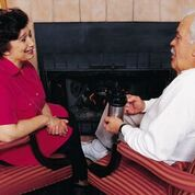 Couple talking fireplace