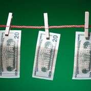 Currency on clothesline