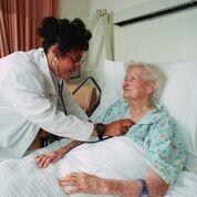 Elderly woman in hospital bed