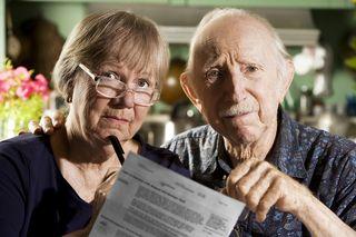 Bigstock-Elder-Couple-With-Bills-3557267(1)